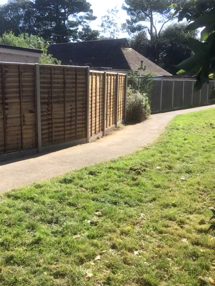 Improved fence and path in a garden cleared by Brookview Landscapes